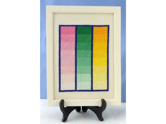 table view of framed Amish quilt block